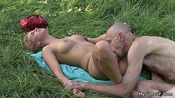 Older man eats son's GF pussy in the fields