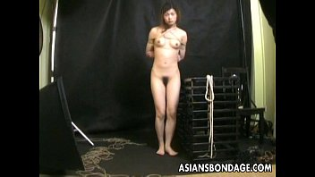 Bound Asian gets treated to a bdsm rope session