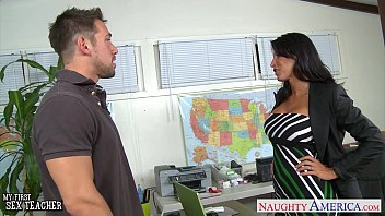 Tanned sex teacher Lezley Zen gives titjob