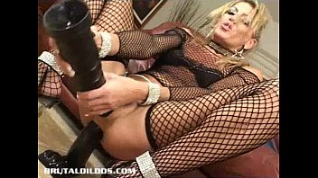 Milf Chelsea Zinn gapes her ass with two b. dildos