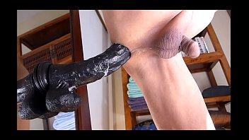 Man masturbating anal with big black dildo and lot of cums.