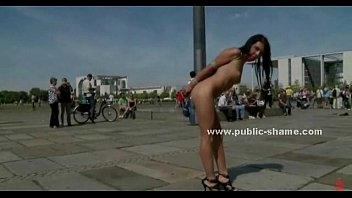 Brunette babe humiliated in public sex