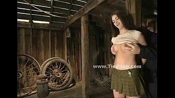 Sexy brunette teen babe bound in barn