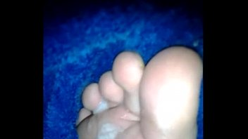 Boy cums on his own foot