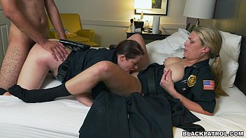 Police officers have threesome with criminal