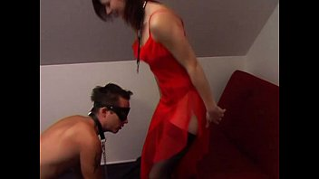Slave boy on a leash like a dog stepped on by mistress's feet
