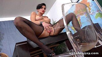 Horny teacher pisses in her classroom before dildo play