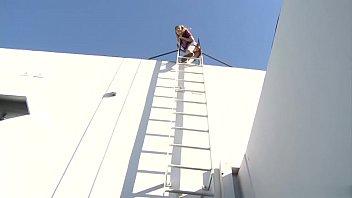 Naughty Nicole Ray fucks stud Bill Bailey on a building roof