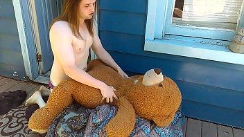 Sissy boy fucking her teddy bear outside