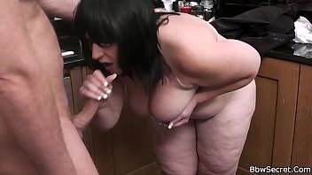 He doggy-fucks BBW at the kitchen