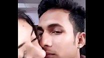 Girlfriend boyfriend kissing in a room