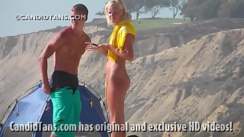 Beautiful blonde teen naked on the beach showing her smooth pussy in public!