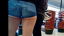 Candid hot girl with booty shorts and big ass showing cheeks (no sound)