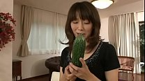 Japanese m. masturbating with a big cucumber