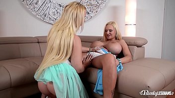 Busty lesbians Kyra Hot & Dolly Fox lick their sexy shaved wet pussies