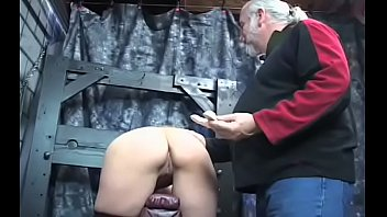 Pretty babe is fucked by a sex tool