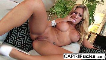Sexy Capri fingers her wet pussy