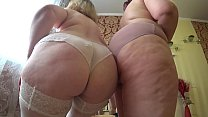Sexual foreplay of two mature lesbians with fat asses, gradual undressing and caress.
