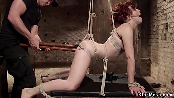 Redhead dp banged in doggy bondage