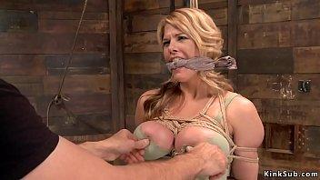 Huge tits sub is suspended on hogtie