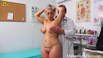 Perverted doctor examines the wet pussy of sexy grandmam