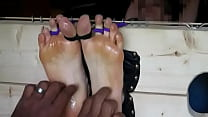 Cute feet tickled in stocks