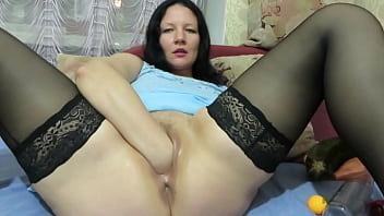 Vaginal fisting, huge zucchini in the vagina, and gaping hole. Chubby milf in stockings stretches her shaved pussy. Homemade organic masturbation.
