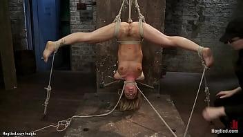 Suspended in an inverted straddle split