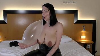 Big busty Milf Shione Cooper plays with a condom