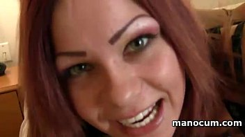 Nasty redhead teasing her breasts in POV and giving handjob