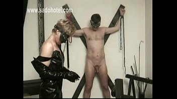 Blond slave is mastrubation cock of tied slave and is spanked on her nice butt in a dungeon