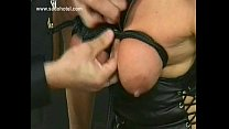 Blond milf slave with big tits is spanked and gets her tits tied together with a rope