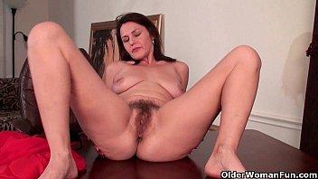 Mature mom finger fucks her hairy pussy