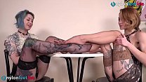 Hot lesbians playing footsies wearing stockings and heels