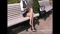 Sexy latina secretary shows off her pantyhosed legs in a park