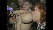 Busty girl shows boobs at Mardi Gras