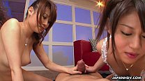 Two hot Asian bitches sucking on the bloke's pecker