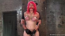 Busty redhead pussy fingered in bondage
