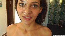 Brunette babe is sprayed with cum