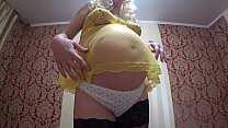 Lesbian with a strap-on standing fucked in the hairy pussy of a pregnant milf in stockings. Fetish.