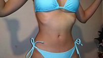 Brunette Desi indoors swimsuit try on