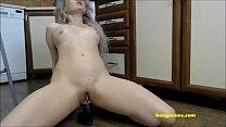 Curly blonde masturbates with her dildo on kitchen